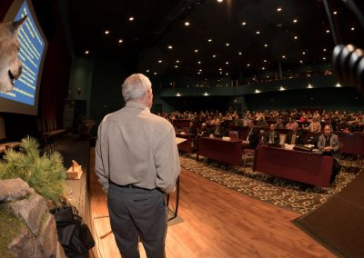 A scientific researcher addresses delegates at the BC Wildlife Federation Conference in Kamloops, BC