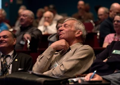 A researcher takes in delegate speeches at a BC Wildlife Federation Conference in Kamloops, BC