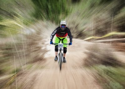 A mountain biker races down the course at the Ranch in Kamloops, BC